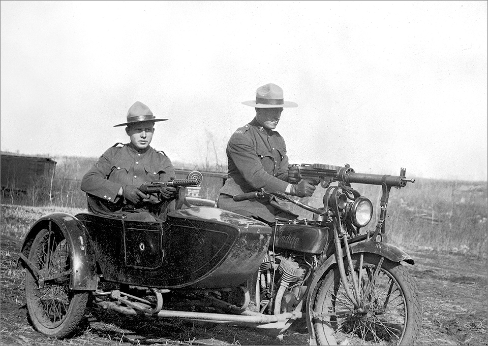 APP Indian motorcycle & sidecar, with guns at the ready