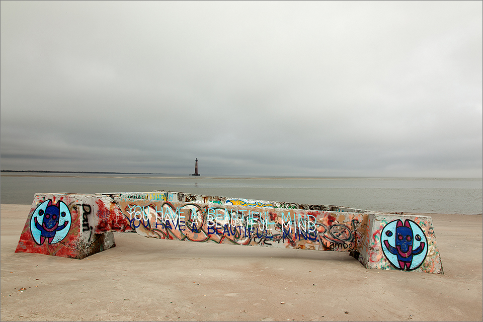 Concrete graffiti, with lighthouse in the distance